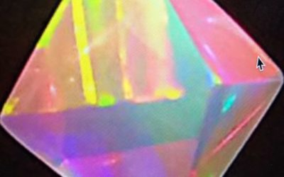 Rainbow colored octahedron on black background